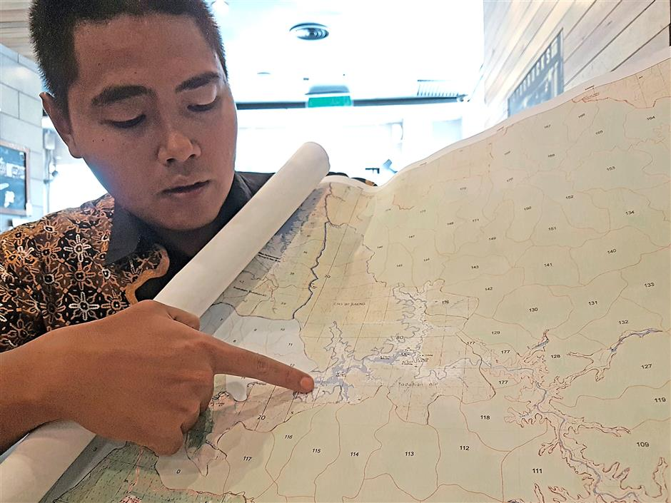 Source of wealth: Amin showing the Muda Dam catchment area.