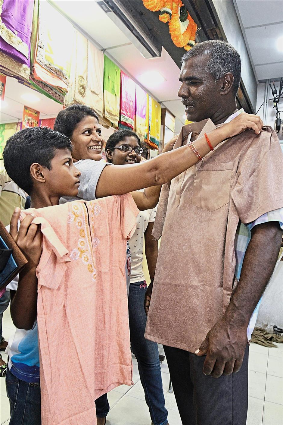Festive preparations: Thiagarajan shopping for Deepavali attire with his family in Little India, Penang.