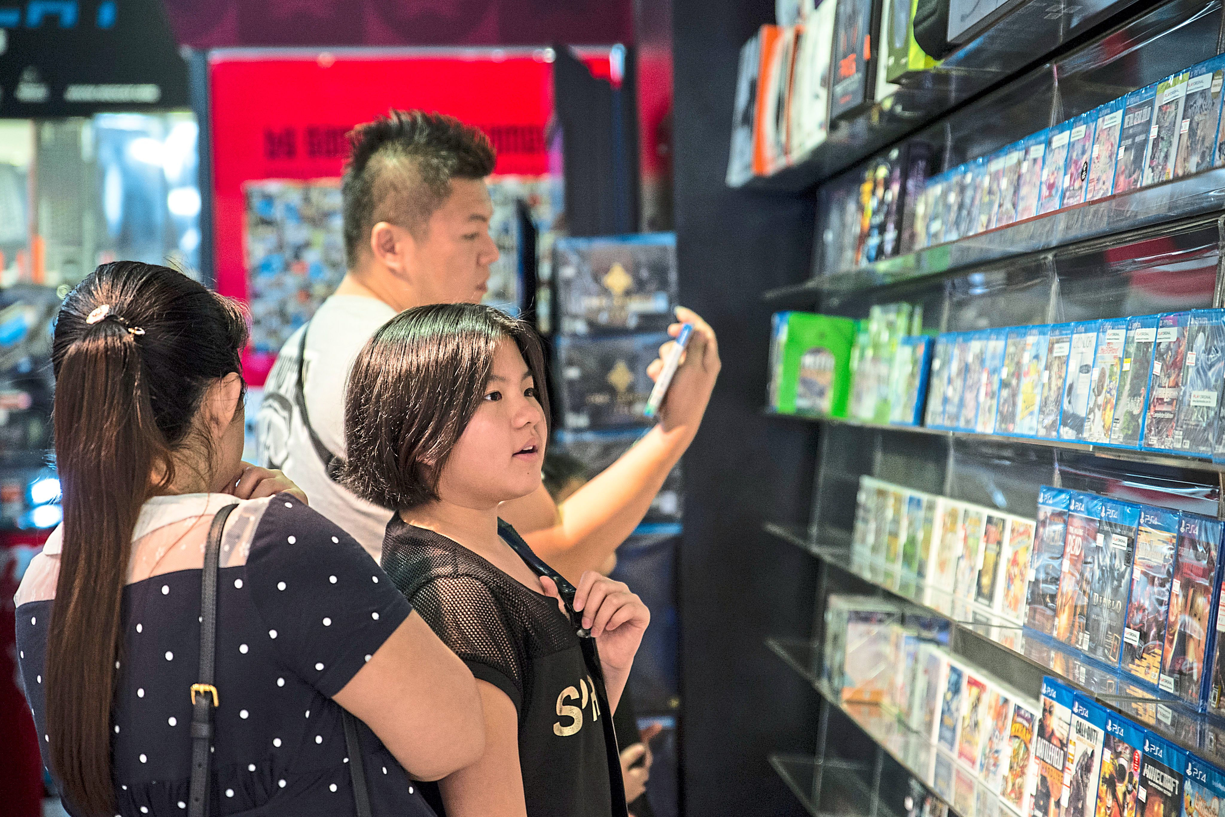 Browsing: with high broadband still not widely available, sales in brick-and-mortar game shops are still good