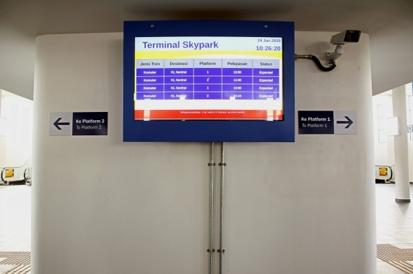 The arrival and departure times for the train service should be posted on the digital information board at the airport.