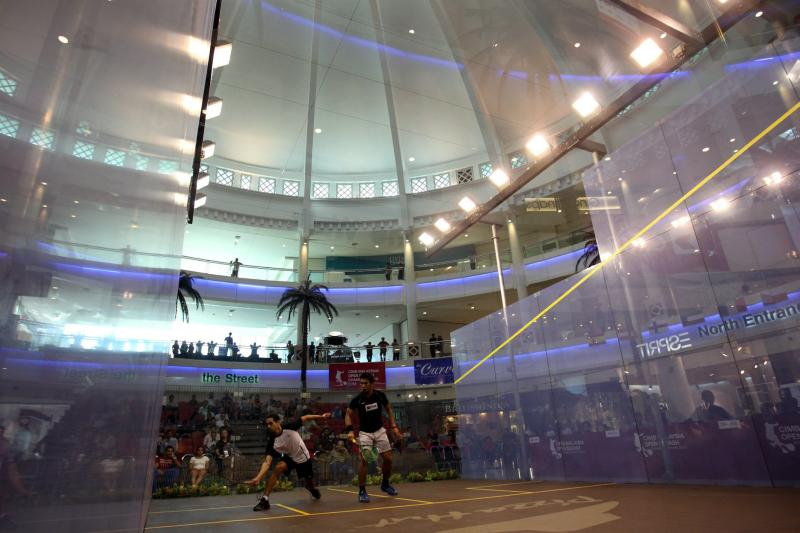 The all-glass showcourt at the Malaysian Open at The Curve.