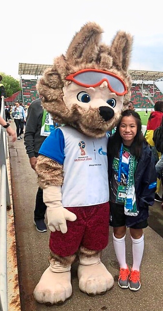 Lauren posing for a photo with Zabivaka, the official World Cup mascot.