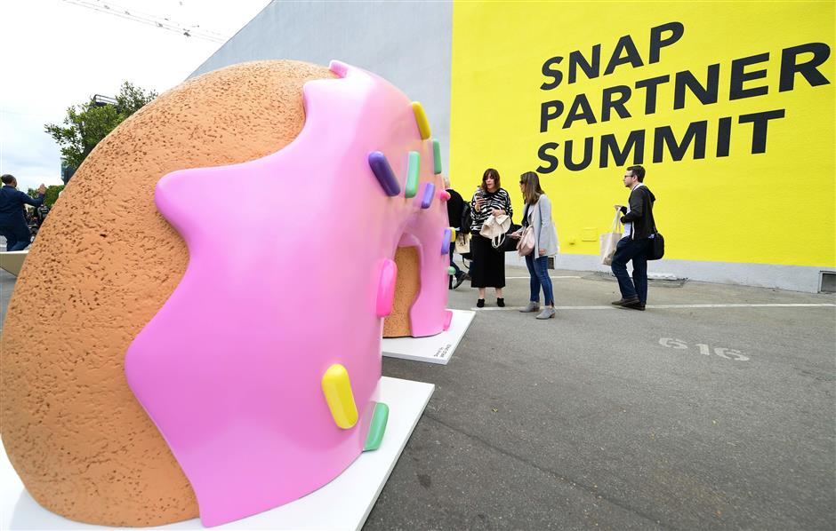 With syndicated stories and an ad network, Snapchat cautiously opens