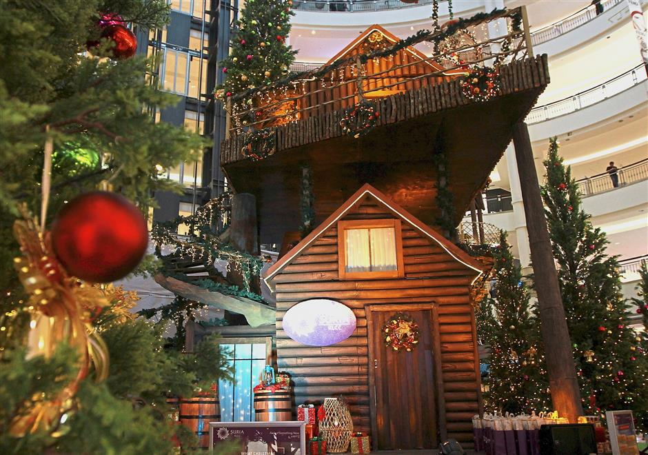 A double-storey cottage connected to a tree house is one of the attractions at Santa's Enchanted Village in Suria KLCC.