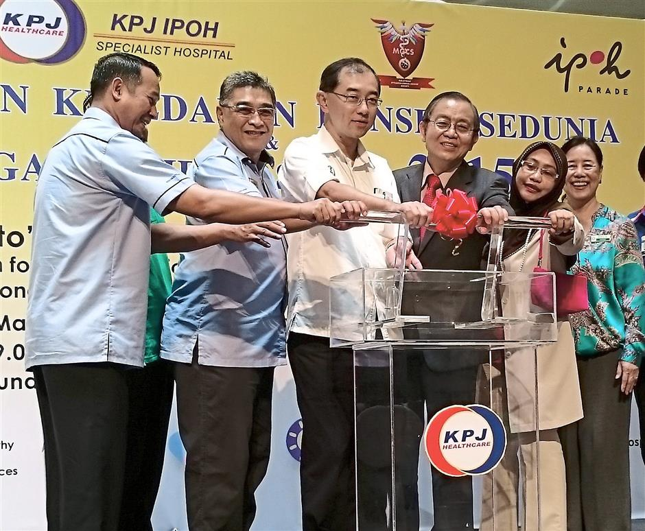 Officially open: Dr Mah (third from left) launching the KPJ Ipoh Specialist Hospital World Cancer Day Campaign. Also present were (from left) the hospital's chief executive officer Asmadi Mohd Bakri, executive director Mohd Nasir Mohamed, medical director Datuk Dr Fadzli Cheah Abdullah and resident Obstetrician and Gynaecology and Gynae-Oncology consultant Dr Zamzida Yusoff, as well as Perak Palliative Care Society vice-president Datin Seri Suraini Kamal (right).