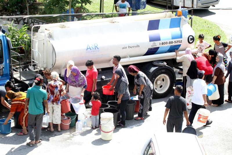 Subang Jaya residents queuing up to collect water from an Air Selangor water tanker on Friday.