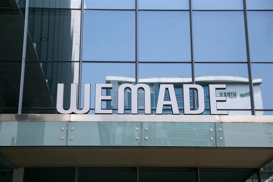 Signage for Wemade Co. is displayed outside the company\'s headquarters in Seongnam, South Korea, on Wednesday, June 5, 2019. Over the last three years, the company\'s chief executive officer Henry Chang has filed about 65 lawsuits in China, Singapore and South Korea against Chinese gaming studios, attempting to block what he alleges are unlicensed versions of his two-decade-old title \'The Legend of Mir.\' Photographer: Jean Chung/Bloomberg