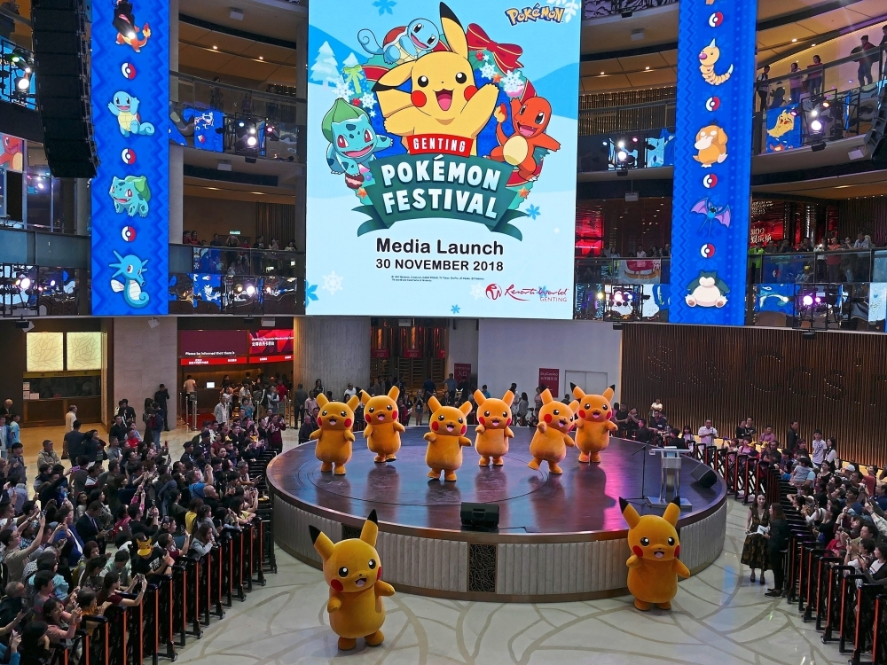 Eight dancing Pikachus delighting the crowd at the launch of the Genting Pokémon Festival.