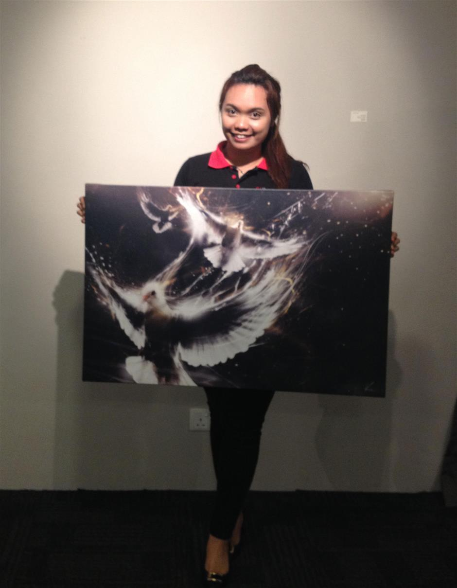 Jouvy Liew became a first time art buyer when she saw Free I being exhibited at the Hotel PI, Ipoh, where she works.