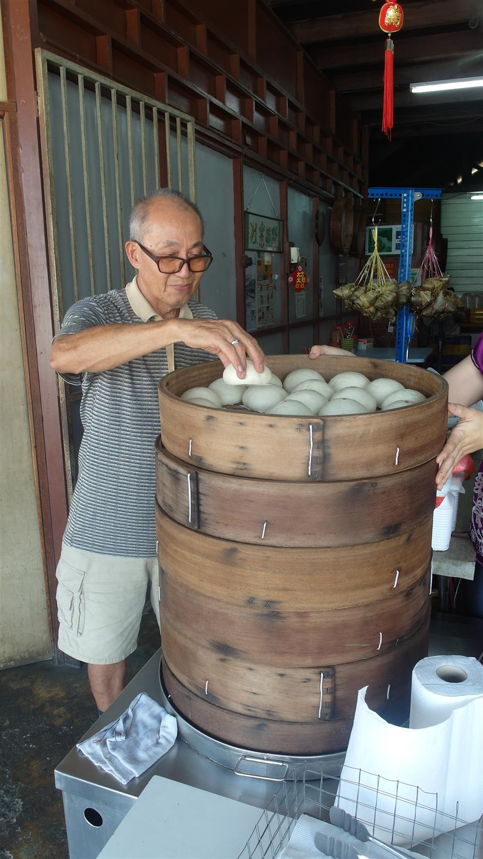 73-year-old Dengkil New Village resident Kiew Wun Fui and his handmade buns which are sold at Hung Cheong Chun coffeeshop.