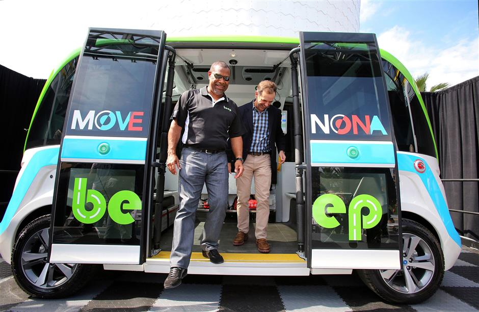 Beep Co-Founder Mark Reid (left) and Tavistock president James Zboril step off the Beep AUTONOM Shuttle vehicle after it was unveiled during a ceremony at Lake Nona Town Center, Tuesday, Feb. 19, 2019. (Joe Burbank/Orlando Sentinel/TNS)