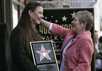 Maria Burton (L), daughter of Richard Burton, is greeted by British Consul-General Dame Barbara Hay at a ceremony posthumously honoring the actor with a star on the Hollywood Walk of Fame.