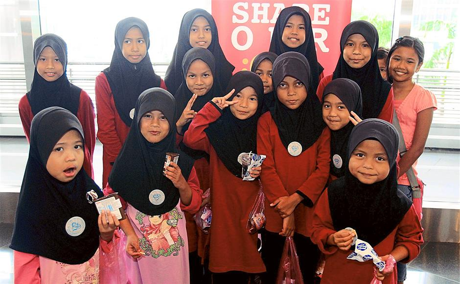 Some of the children from Rumah Amal Cheshire showing their goodie bags from The Rotary Club of Pudu.