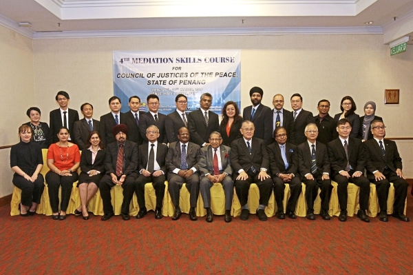 Penang Council of Justices of Peace      committee members  posing for the camera with the course participants.