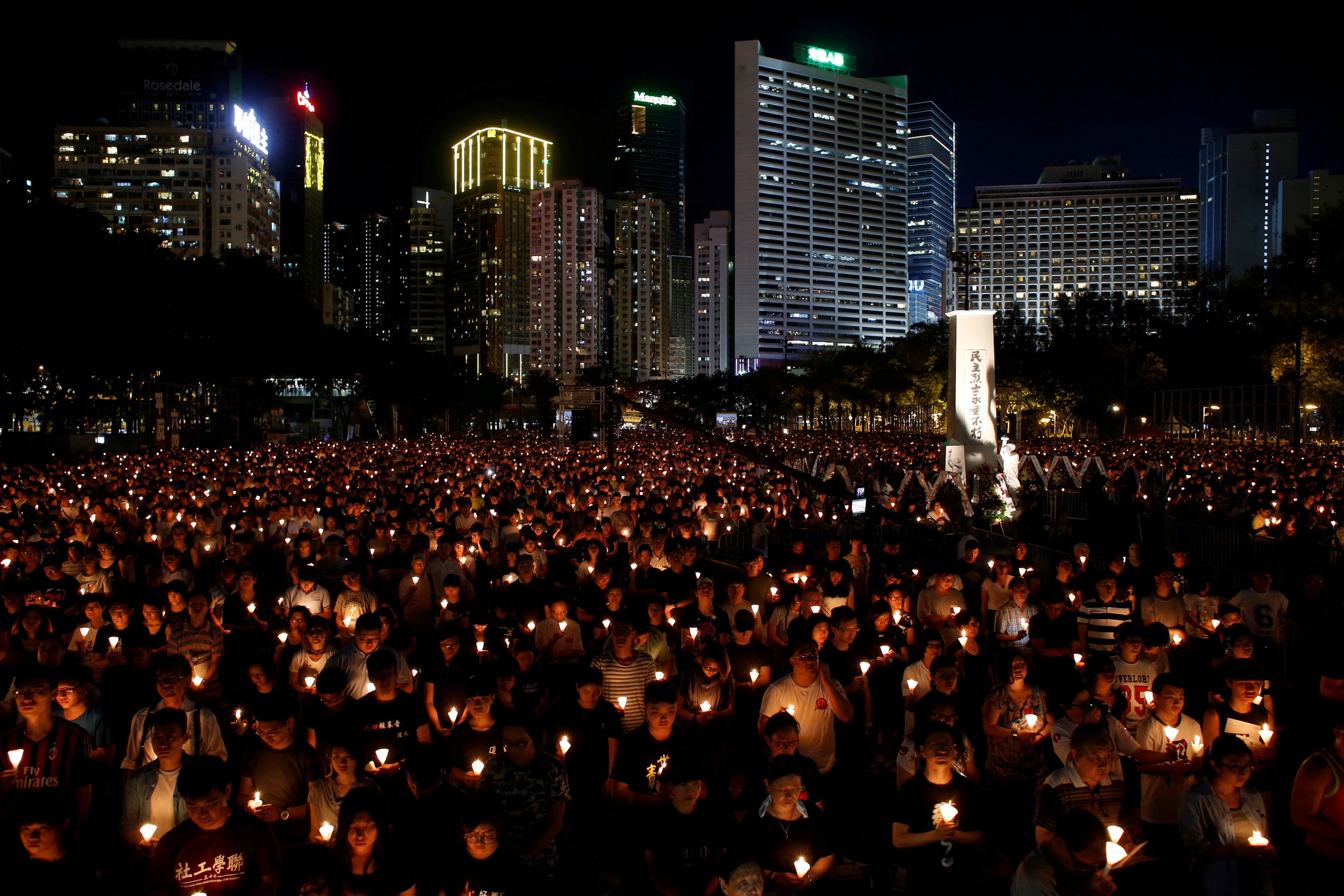 FILE PHOTO: Thousands of people take park in a candlelight vigil to mark the 27th anniversary of the crackdown of pro-democracy movement at Beijing's Tiananmen Square in 1989, at Victoria Park in Hong Kong June 4, 2016. REUTERS/Bobby Yip/File Photo
