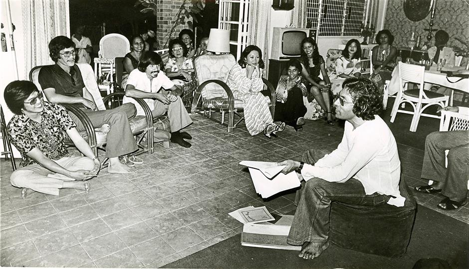 Cecil Rajendra (right) having a discussion with the audience at a poetry meet in Penang in July 1978.