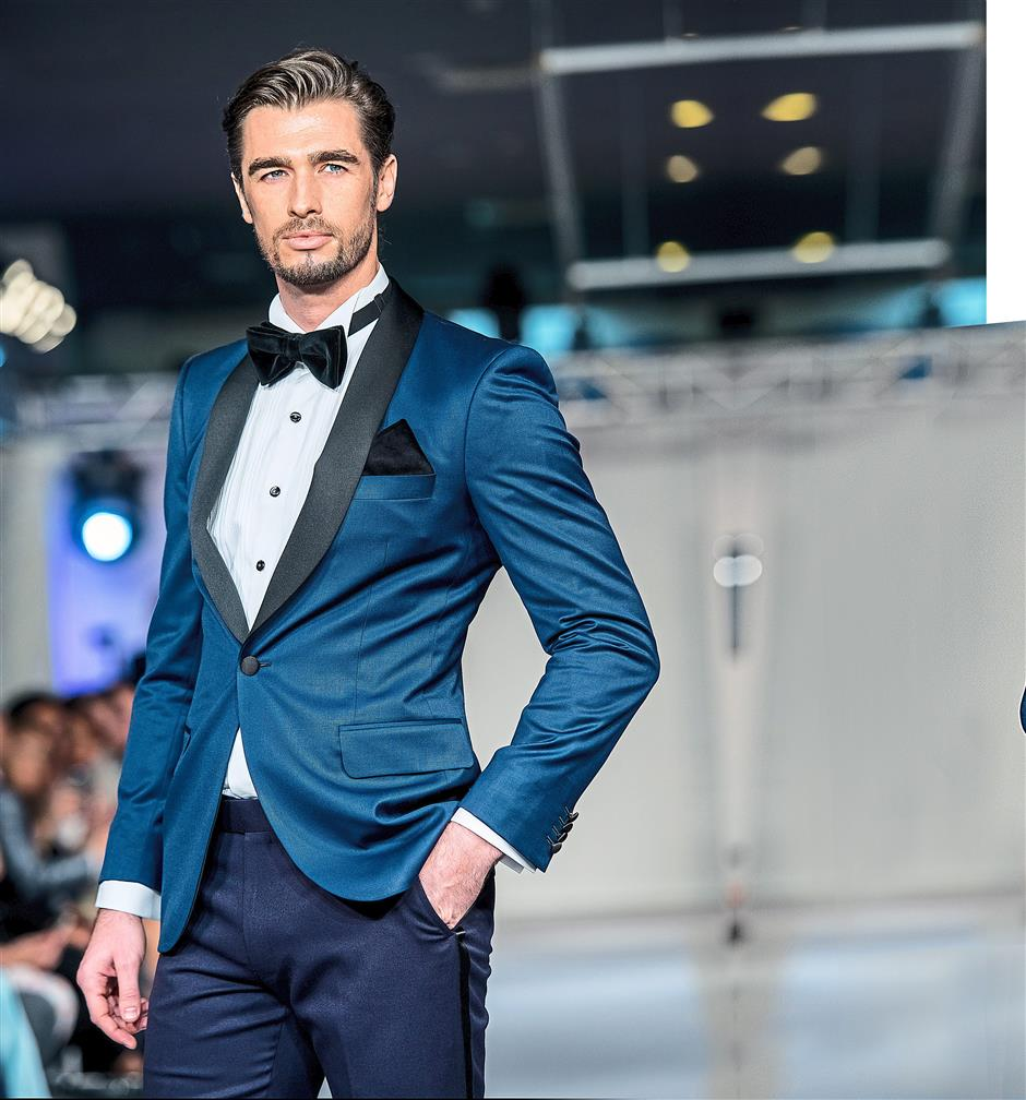 Man of the hour: A Lord's Tailor suit cuts a dashing figure on the runway. — Photo: Lord's Tailor