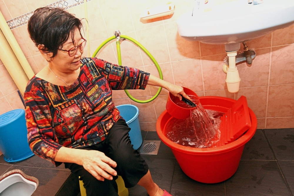 Hew soaks her dirty clothes in soapy water and washes them with a shorter rinsing period. She uses the remaining soap water to wash the toilet.