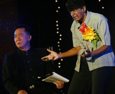 Two classic Instant Cafe Theatre characters, u2018Talk show hostu2019 Patrick Teoh (left) and u2018Deputy Minister of Breaking Recordsu2019 Jo Kukathas, in a 2011 performance in Penang.