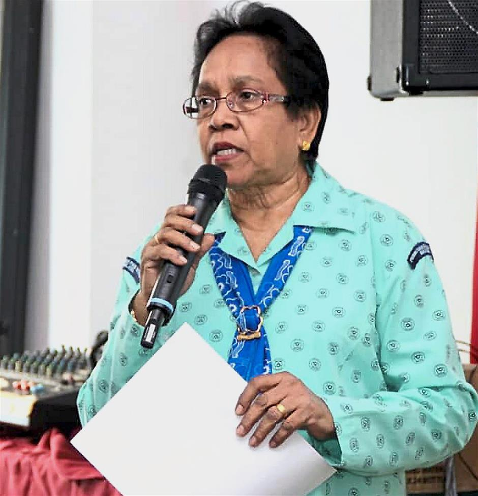 Right: Jeyadhevi has played a pivotal role in the development of girl guiding in Malaysia and has received a string of state, national and international awards for her efforts.