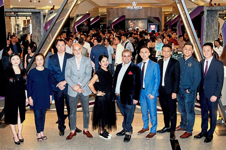 Sharan (sixth from left) with representatives of the brand partners at the launch of Revolution by Time Kulture organised by Swiss Watch Gallery in Pavilion Kuala Lumpur. — Photos by M. AZHAR ARIF/The Star