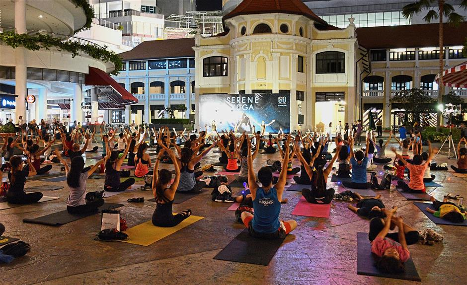 Serene Yoga participants having their session in relative darkness after non-essential lights were switched off or dimmed at Gurney Paragon Mall.