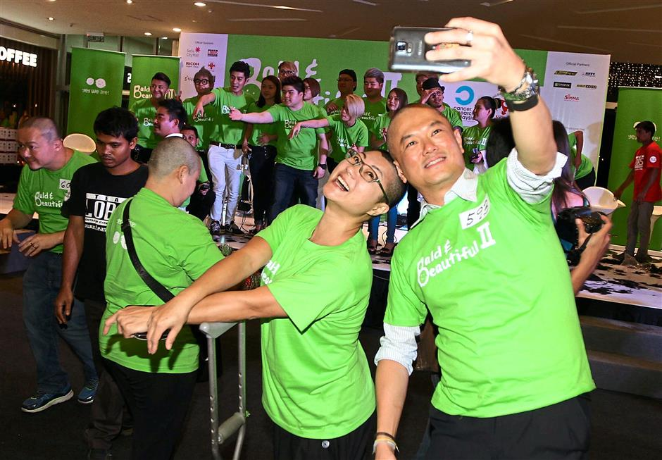 Participants capturing the moment with a celebratory selfie.— Photos: CHAN TAK KONG/The Star