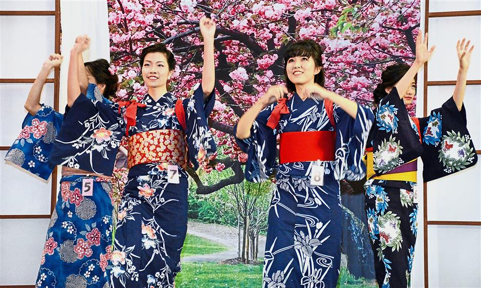 Pageant finalists, including runner up Chia (second right) doing a dance in yukatas during the opening round.