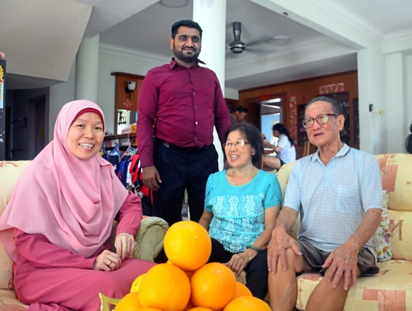 Happy family: (From left) Azura, Rafaqat, Sock Huay and Boon Hock at their home.