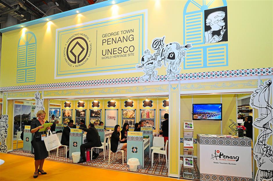 Promoting Malaysia: The ITB Asia 2014 trade show included 744 exhibitors from various countries. Pictured is the Penang Global Tourism booth.