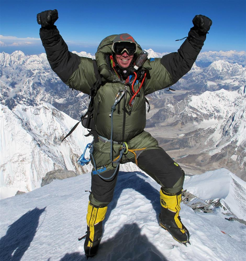 Founder and head guide of Alpenglow Expeditions Adrian Ballinger celebrating on May 18 last year as he reaches the summit of Mount Everest for the sixth time.