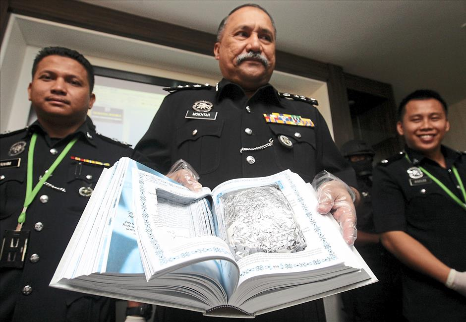 Sneaky attempt: Comm Mokhtar showing the stash of syabu hidden in a religious book during a press conference at the federal police headquarters in Bukit Aman, Kuala Lumpur.