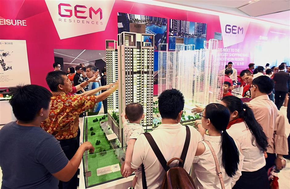 Potential buyers taking a closer look at the Gem Residences model during the launch.