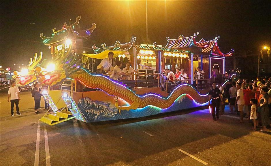 One of the highlights is a float featuring dragon heads.