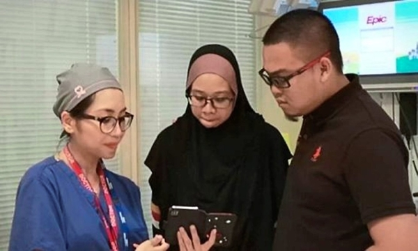 Assuring hand: Dr Nur Amalina (left) with Nurul Erwani and Ahmad Safiuddin after the successful surgery.