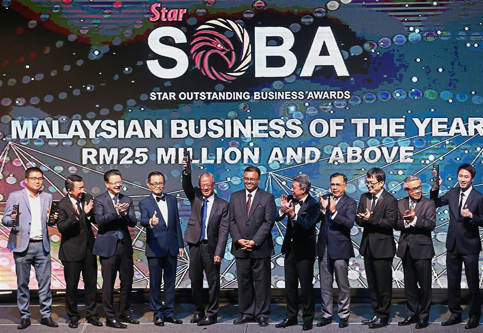 Unforgettable night: A jubilant Lim (fifth from left) after being awarded the title at the SOBA 2019. With him are (from left) Linaco Manufacturing Sdn Bhd managing director Joe Ling, RHB head of Group Business and Transaction Banking Jeffrey Ng, PKT group chief executive and managing director Datuk Michael Tio, Fu, Isham, Wong, CGC president and chief executive officer Datuk Mohd Zamree Mohd Ishak, Digi chief business officer Eugene Teh, Matrade deputy chief executive officer Datuk Wan Latiff Wan Musa, Secret Recipeu2019s business development director Patrick Sim, Veritas Architectsu2019 HR/career development manager Latha Ramasamy and Secret Recipeu2019s senior marketing manager Evelyn Lee.
