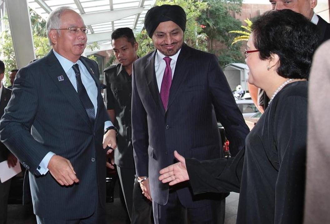 Prime Minister Datuk Seri Mohd Najib Tun Razak accompanied by the Chairman of Securities Commission Malaysia Datuk Ranjit Ajit Singh during the World Capital Market Symposium at Mandarin Oriental Hotel on Tuesday.
