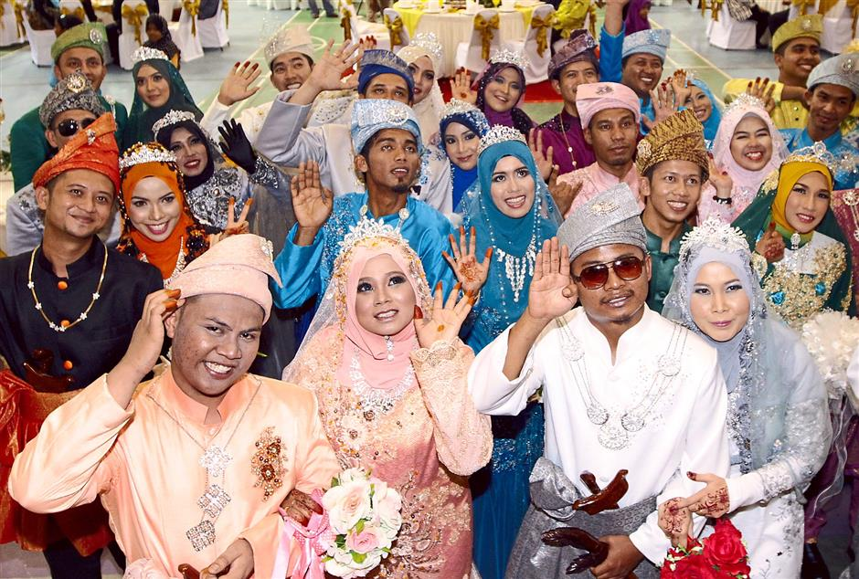 Starting life together:  The couples showing their happiness at the banquet held at the Balik Pulau Complex.