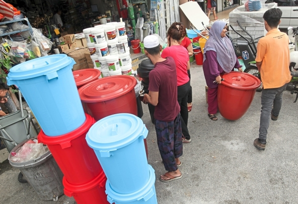 People buying large water containers at Segambut Bahagia, Kuala Lumpur, to prepare for the four-day water disruption.