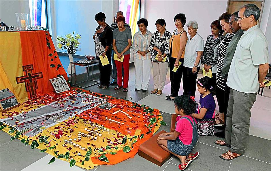 In memory: A group of people praying at the Council of Churches of Malaysia chapel in Petaling Jaya.