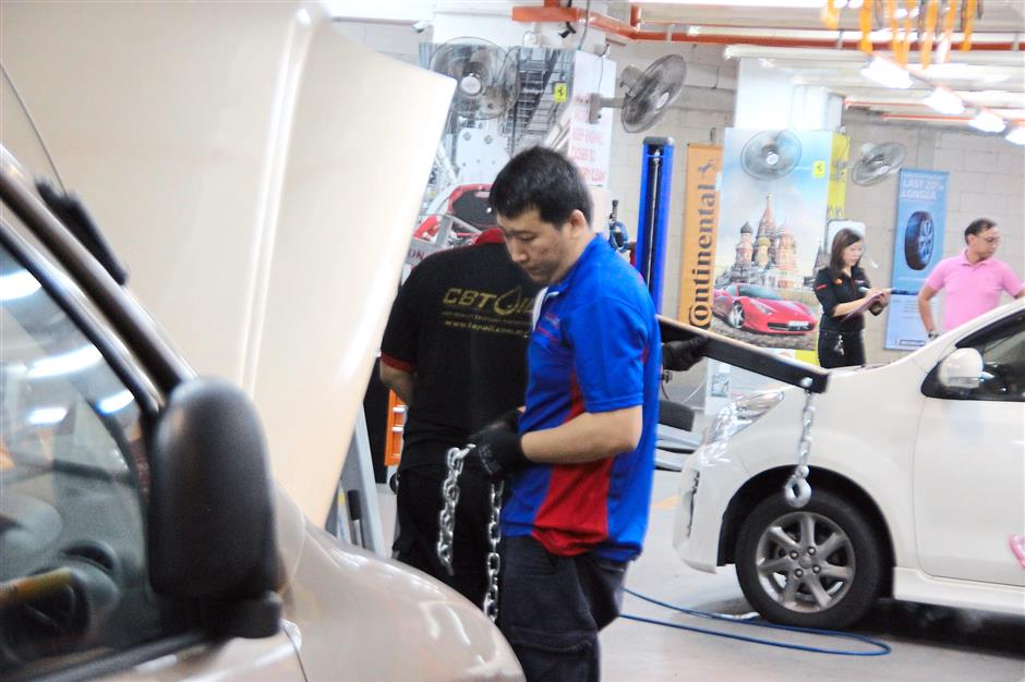 Greasy no more: Citicars auto service centres are a change from your hot, greasy traditional workshop .