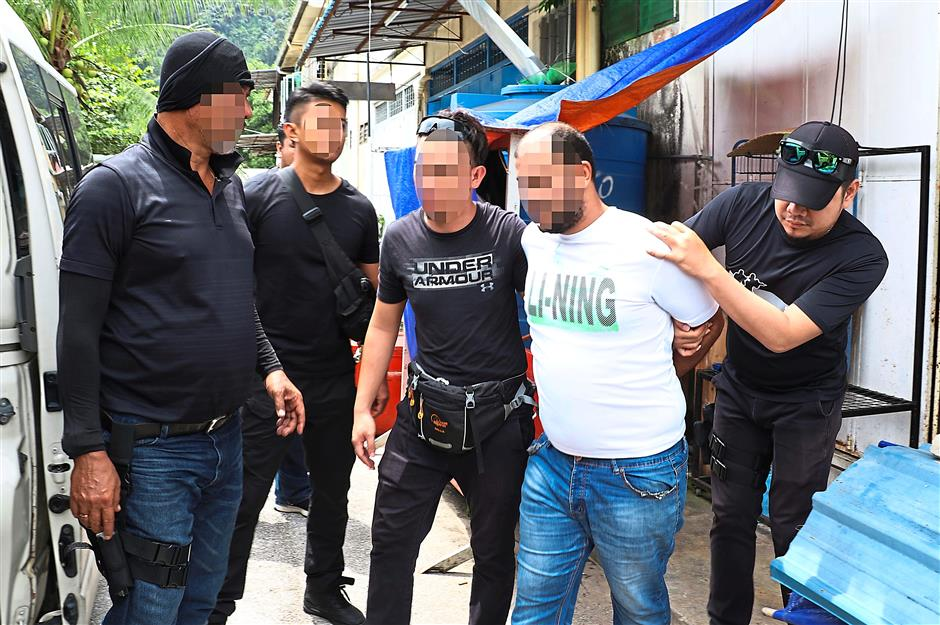 No more place to hide: Counter Terrorism Special Unit officers apprehending a suspected militant during several raids made in Klang Valley and Serian in Sarawak. Nine individuals aged between 20 and 54 were arrested during the raids. — Bernama