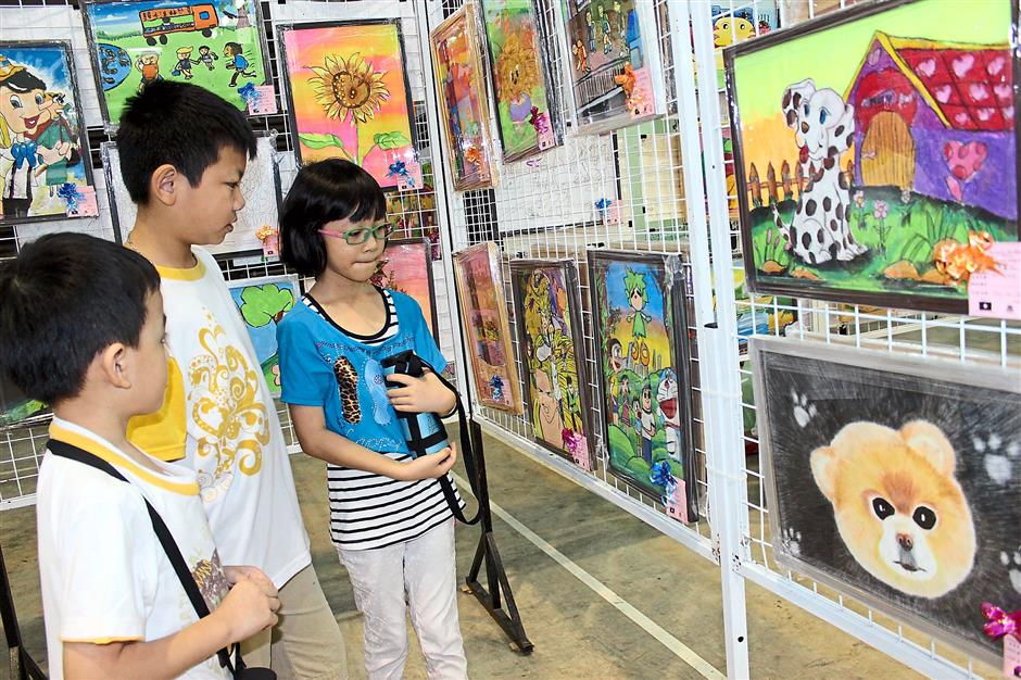 Bright and beautiful: A group of young visitors checking out some of the work produced by the participants.