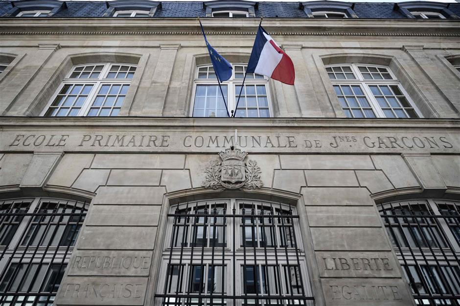 This picture taken on June 27, 2019 shows the Vaugirard elementary school in Paris. - The bells will ring for the last time next week when pupils at Vaugirard elementary school in central Paris leave on holidays, the latest school in the city to close as spiralling property prices drive families out of the capital. (Photo by Philippe LOPEZ / AFP)
