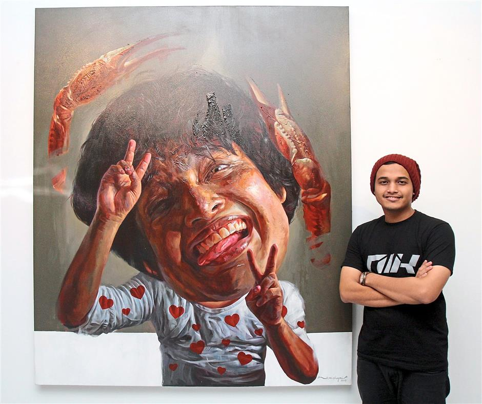 Prawn lover: Nik Mohd Shazmie with his 'Allergy' painting which is his visual account of his allergy to seafood. His paintings reveal his mischievous personality.