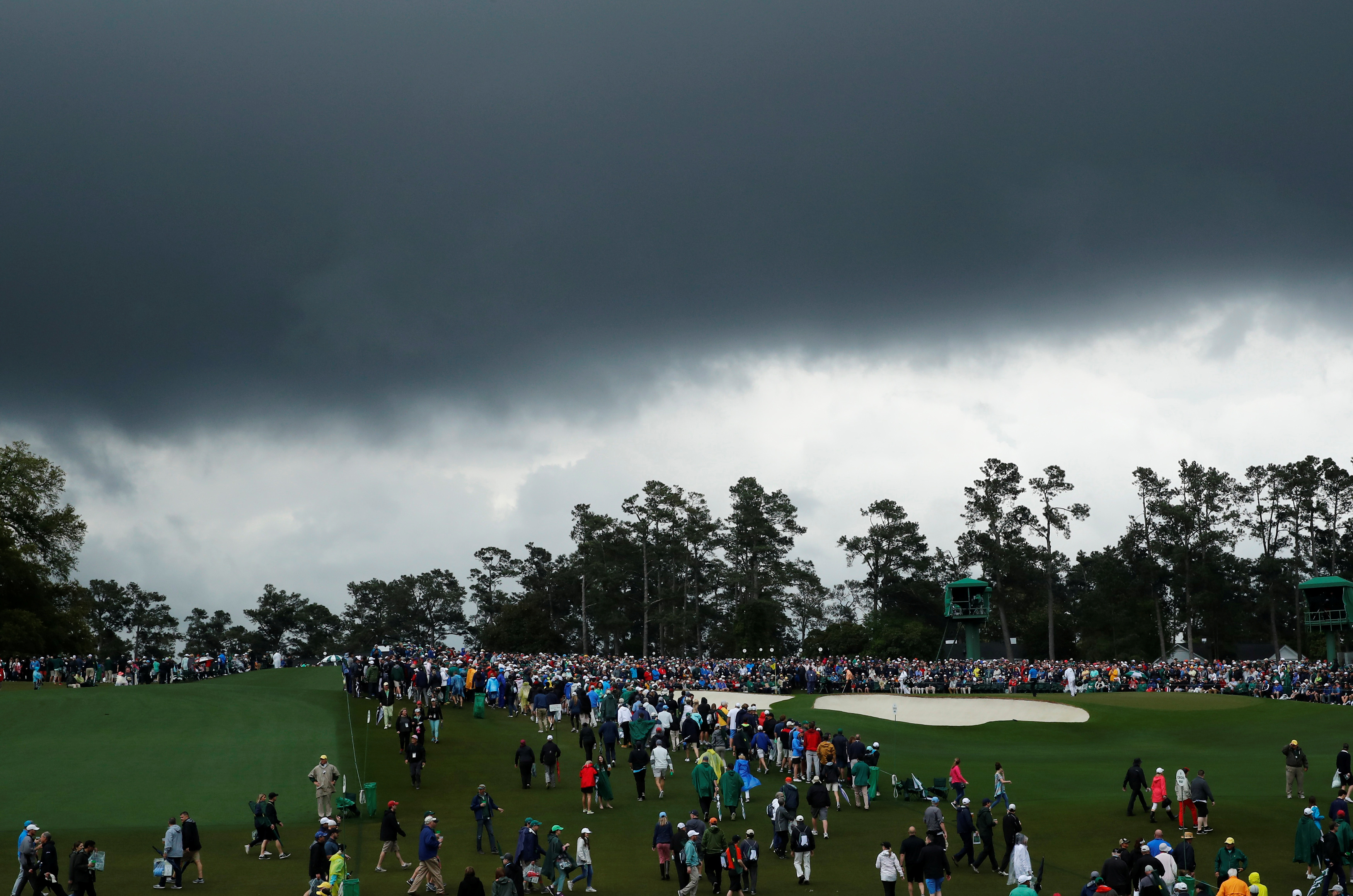 FILE PHOTO: Stormy skies loom over the course during third round play of the 2018 Masters golf tournament at the Augusta National Golf Club in Augusta, Georgia, U.S. April 7, 2018. REUTERS/Mike Segar/File Photo