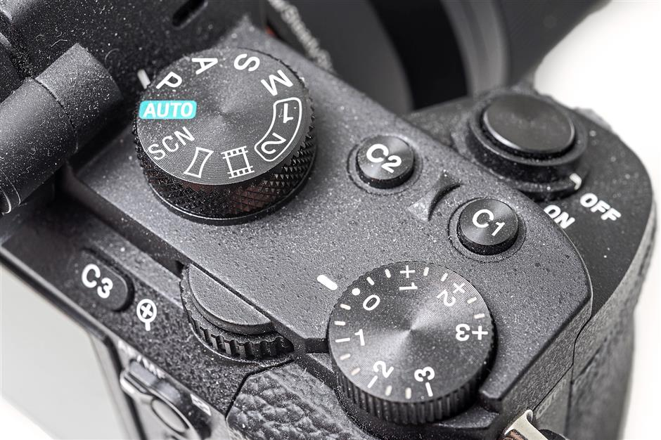 The top plate of the Sony A7 II has been redesigned with the shutter release now on the front.