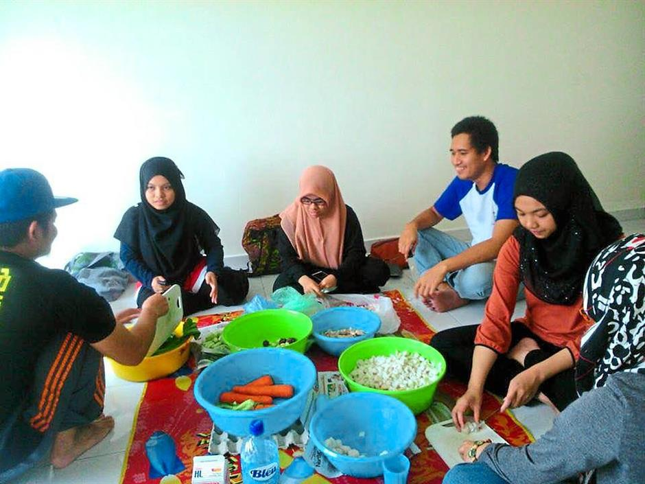 The Nasi Lemak Project volunteers meet at a house sponsored to them where they cook and prepare food to feed the homeless.