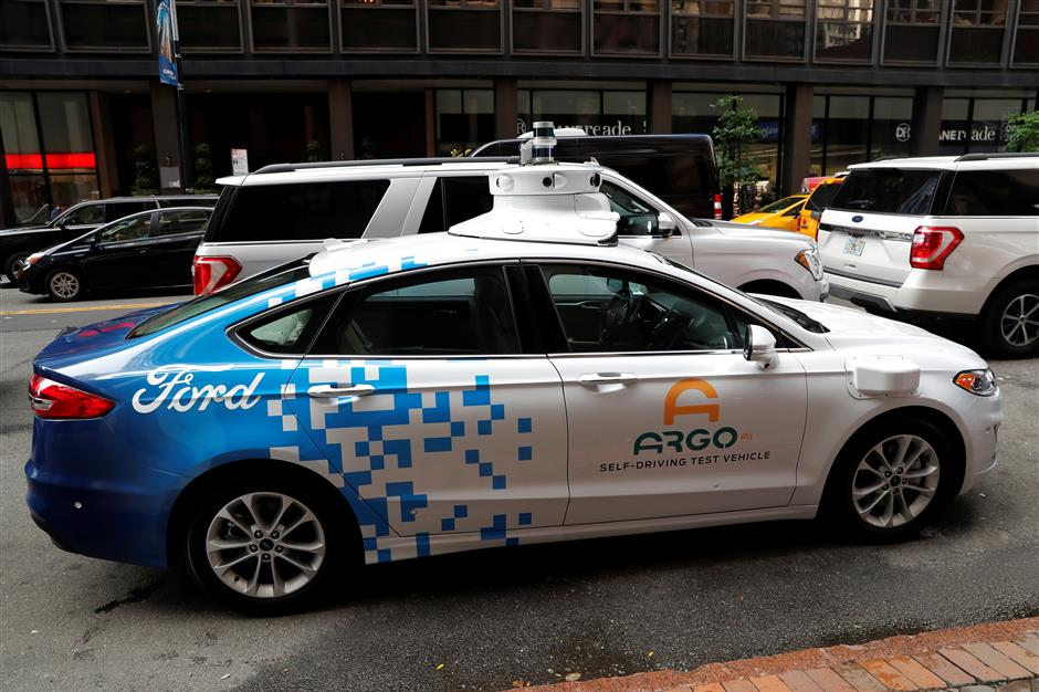 An Argo Ai self driving prototype vehicle is seen outside a Ford and Volkswagen joint news conference in New York City, New York, U.S., July 12, 2019. REUTERS/Mike Segar