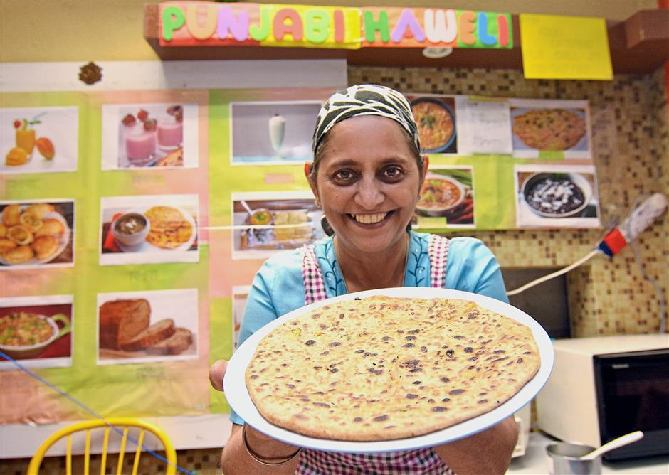 Charanjit from Punjabi Haweli offers curry mee and puri in addition to a variety of dishes.